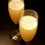 The Cadillac of champagne-based cocktails. Although this drink traditionally is served long (in a tall glass with ice), it's also festive stirred together with ice and strained into a flute glass or wine glass.